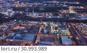 Купить «Aerial view of chemical process plant near Tarragona, Spain», видеоролик № 30993989, снято 20 мая 2019 г. (c) Яков Филимонов / Фотобанк Лори