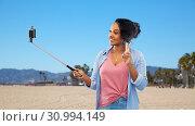 Купить «african american woman taking selfie by smartphone», фото № 30994149, снято 2 марта 2019 г. (c) Syda Productions / Фотобанк Лори