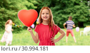 Купить «smiling red haired girl with heart shaped balloon», фото № 30994181, снято 9 марта 2019 г. (c) Syda Productions / Фотобанк Лори