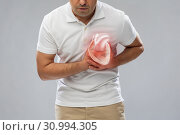 Купить «close up of man having heart attack or heartache», фото № 30994305, снято 21 декабря 2016 г. (c) Syda Productions / Фотобанк Лори
