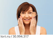 senior woman with zoomed eye wrinkles in pointer. Стоковое фото, фотограф Syda Productions / Фотобанк Лори