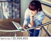 Купить «high school student girl reading book at library», фото № 30994493, снято 19 июня 2016 г. (c) Syda Productions / Фотобанк Лори