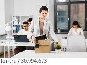 Купить «sad female office worker packing personal stuff», фото № 30994673, снято 23 марта 2019 г. (c) Syda Productions / Фотобанк Лори