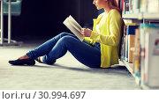 Купить «high school student girl reading book at library», фото № 30994697, снято 19 июня 2016 г. (c) Syda Productions / Фотобанк Лори