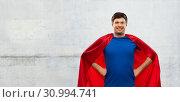 Купить «man in red superhero cape over concrete background», фото № 30994741, снято 3 февраля 2019 г. (c) Syda Productions / Фотобанк Лори