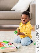 Купить «african american baby boy playing with toy blocks», фото № 30994825, снято 22 марта 2019 г. (c) Syda Productions / Фотобанк Лори