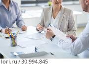 Купить «business team discussing report at office», фото № 30994845, снято 28 марта 2018 г. (c) Syda Productions / Фотобанк Лори