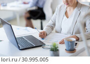 Купить «businesswoman with papers working at office», фото № 30995005, снято 28 марта 2018 г. (c) Syda Productions / Фотобанк Лори