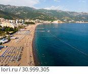 Купить «Becici, Montenegro - June 12.2019. Beautiful top view of the beach with people.», фото № 30999305, снято 11 июня 2019 г. (c) Володина Ольга / Фотобанк Лори