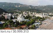 Купить «Becici, Montenegro - June 11.2019. View of hotels in popular resort village of Becici», видеоролик № 30999313, снято 18 августа 2019 г. (c) Володина Ольга / Фотобанк Лори