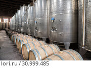 Купить «Fermentation tanks for wine production and wooden  tun for wine aging of the plant Kindzmarauli Corporation», фото № 30999485, снято 1 октября 2018 г. (c) Юлия Бабкина / Фотобанк Лори
