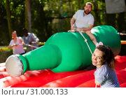 Купить «Smiling woman trying to throw friend off», фото № 31000133, снято 19 сентября 2019 г. (c) Яков Филимонов / Фотобанк Лори