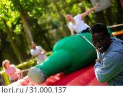 Купить «Nice African American man trying to throw female», фото № 31000137, снято 19 сентября 2019 г. (c) Яков Филимонов / Фотобанк Лори