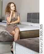 Купить «Girl testing mattress in salon», фото № 31000305, снято 22 октября 2018 г. (c) Яков Филимонов / Фотобанк Лори