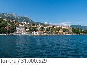Купить «Herceg Novi, Montenegro - June 10. 2019. Panorama of the city from the sea», фото № 31000529, снято 10 июня 2019 г. (c) Володина Ольга / Фотобанк Лори