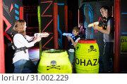 Купить «Parents and children playing laser tag», фото № 31002229, снято 6 июня 2018 г. (c) Яков Филимонов / Фотобанк Лори