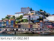 Купить «View buildings in Ribeira District and Bishop's Palace in Porto on Iberian Peninsula», фото № 31002661, снято 17 июля 2018 г. (c) Николай Коржов / Фотобанк Лори