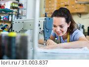 Young woman tailor working on sewing machine. Стоковое фото, фотограф Яков Филимонов / Фотобанк Лори