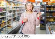 Купить «woman visiting supermarket food department», фото № 31004005, снято 8 февраля 2019 г. (c) Яков Филимонов / Фотобанк Лори