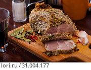 Купить «Appetizing pork ham with spices on a cutting board», фото № 31004177, снято 17 июля 2019 г. (c) Яков Филимонов / Фотобанк Лори