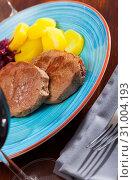 Купить «Veal steak with potato and sauerkraut», фото № 31004193, снято 26 июня 2019 г. (c) Яков Филимонов / Фотобанк Лори