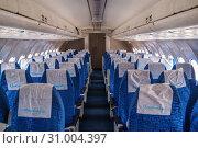 Interior passenger jet Tu-154B-2. Orenburg, Russia - May 04, 2019: Orenair airliner at the Civil Aviation Museum at Gagarin Airport. Редакционное фото, фотограф Вадим Орлов / Фотобанк Лори