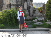 Купить «Pyongyang, North Korea. Pioneer girl», фото № 31004641, снято 29 апреля 2019 г. (c) Знаменский Олег / Фотобанк Лори
