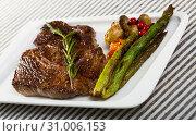 Купить «Fried steak entrecote of beef with mushroom and asparagus», фото № 31006153, снято 29 июня 2018 г. (c) Яков Филимонов / Фотобанк Лори