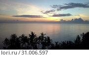 Купить «Sunrise on the tropical sea. Aero shooting from the drone», видеоролик № 31006597, снято 7 июня 2018 г. (c) Куликов Константин / Фотобанк Лори
