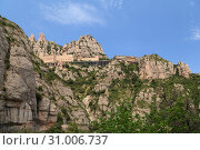 View of the Santa Maria de Montserrat Abbey from the Santa Cova funicular bottom station (2013 год). Стоковое фото, фотограф Анна Иноземцева / Фотобанк Лори