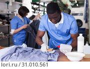 Купить «Laundry worker during daily work», фото № 31010561, снято 15 января 2019 г. (c) Яков Филимонов / Фотобанк Лори