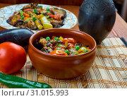 Bulgarian guvec , Dish of stewed vegetables and greens, close up. Стоковое фото, фотограф Zoonar.com/MYCHKO / easy Fotostock / Фотобанк Лори