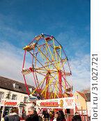 Купить «Red and yellow carousel wheel outside with people below blue sky christmas fair, essex, england, uk», фото № 31027721, снято 2 декабря 2017 г. (c) easy Fotostock / Фотобанк Лори