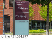 Купить «Entrance to the Federal Environmental Agency in Dessau in the foreground a sign with inscription in German - entrance, entrance Federal Environment Agency», фото № 31034877, снято 5 августа 2018 г. (c) easy Fotostock / Фотобанк Лори