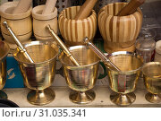 Metal mortars and pestles as a traditional kitchenware. Стоковое фото, фотограф YAY Micro / easy Fotostock / Фотобанк Лори