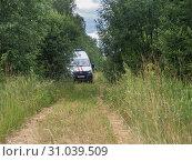 Купить «Автомобиль спасателей в природной среде», фото № 31039509, снято 25 июня 2019 г. (c) Сайганов Александр / Фотобанк Лори