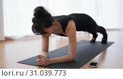 Barefoot woman n plank on arms is doing pilates programm at gym slow motion. Стоковое видео, видеограф Denis Mishchenko / Фотобанк Лори
