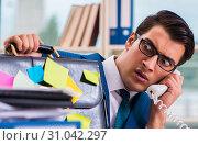 Купить «Businessman with reminder notes in multitasking concept», фото № 31042297, снято 26 сентября 2017 г. (c) Elnur / Фотобанк Лори