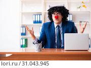 Купить «Young clown businessman working in the office», фото № 31043945, снято 14 декабря 2018 г. (c) Elnur / Фотобанк Лори