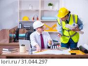 Купить «Two architects working on the project», фото № 31044297, снято 3 апреля 2019 г. (c) Elnur / Фотобанк Лори