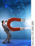 Купить «Businessman catching dollars on horseshoe magnet», фото № 31044389, снято 17 февраля 2020 г. (c) Elnur / Фотобанк Лори
