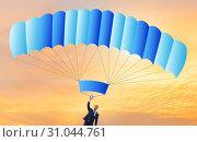Купить «Young businessman falling on parachute in business concept», фото № 31044761, снято 30 мая 2020 г. (c) Elnur / Фотобанк Лори