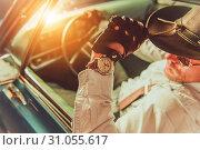 Купить «Western Wear Driver. Caucasian Cowboy in the Hat Driving His Classic Muscle Car», фото № 31055617, снято 16 июля 2019 г. (c) easy Fotostock / Фотобанк Лори