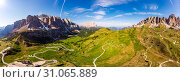 Dolomites - Beautiful panoramic sunset landscape at Gardena Pass (Passo Giau) near Ortisei. Stunning airial view on the top Dolomiti Alps Mountains from drone on summer day, Italy, south Tyrol Europe. Стоковое фото, фотограф Алексей Ширманов / Фотобанк Лори