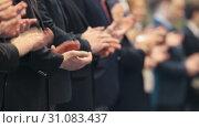 Купить «Business people in costumes standing in the row at the conference - clapping their hands», видеоролик № 31083437, снято 16 июля 2019 г. (c) Константин Шишкин / Фотобанк Лори