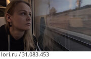 Купить «Woman on railway trip. Time to think and enjoy the view», видеоролик № 31083453, снято 21 сентября 2019 г. (c) Данил Руденко / Фотобанк Лори