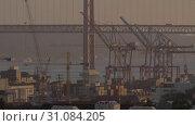 Купить «Container port and car bridge», видеоролик № 31084205, снято 20 сентября 2019 г. (c) Данил Руденко / Фотобанк Лори