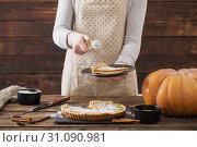 Купить «woman cooks pumpkin pie», фото № 31090981, снято 23 ноября 2018 г. (c) Майя Крученкова / Фотобанк Лори