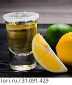 Купить «Tequila drink served in glasses with lime and salt», фото № 31091429, снято 18 сентября 2017 г. (c) Elnur / Фотобанк Лори