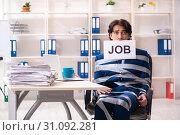 Купить «Young tied male employee in the office», фото № 31092281, снято 18 декабря 2018 г. (c) Elnur / Фотобанк Лори